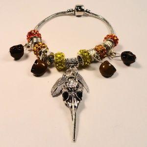 Jewelry - Orange charm bracelet dangle Skulls & Bird Skull